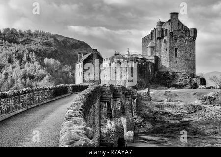 B&W image - Eilean Donan Castle on the shore of Loch Duich near Dornie in Wester Ross, Highland Region, Scotland - Stock Image