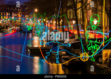 Amsterdam canal Herengracht during Amsterdam Light Festival with artwork 'Paths Crossing' of Ralf Westerhof. - Stock Image