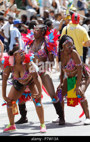 Montreal, Canada. 7/7/2018. Women dancing in the  Carifiesta parade in downtown Montreal. Credit: richard prudhomme/Alamy Live News - Stock Image
