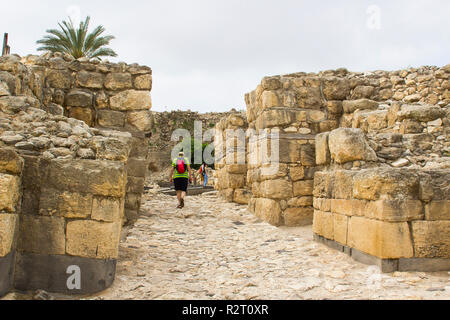 5 May 2018 Tourists at the Bronze Age entrance to the excavated ruins of the ancient city of Meggido in Northern Israel. This place is otherwise known - Stock Image