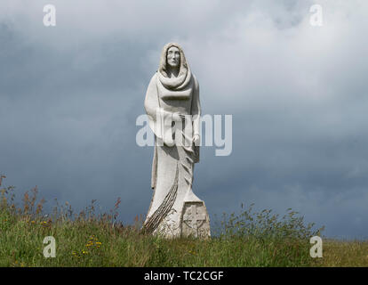 Stz Ninnog granite sculpture at the Valley of the Saints, Quenequillec, Brittany, France. - Stock Image