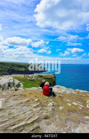 Tourists enjoying the view,Tintagel castle Island Peninsular,Cornwall,England,UK - Stock Image