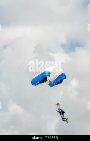 Parachutist using a parafoil type parachute. - Stock Image
