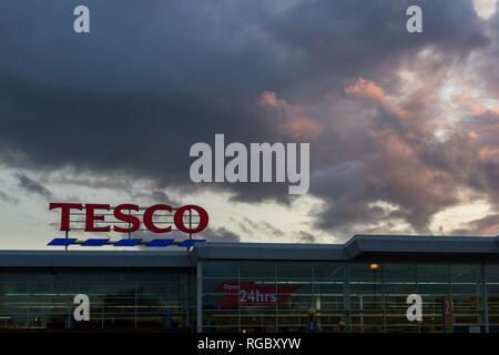 Sunset over Tesco's 24 hour store, Lisburn, N.Ireland. - Stock Image