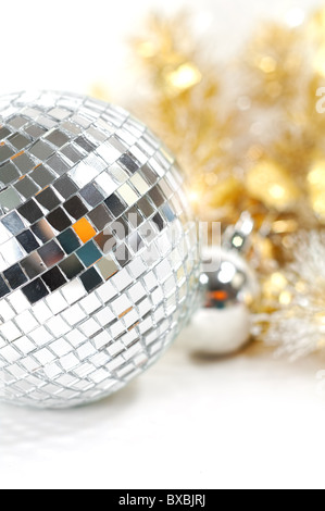 Christmas background with disco ball and decoration in gold - Stock Image