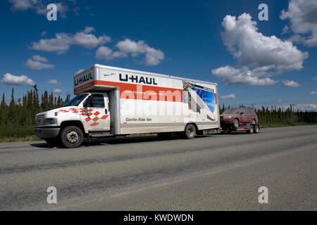 U-haul van with car towing trailer on the move in Alaska, Northern America, United States of America - Stock Image