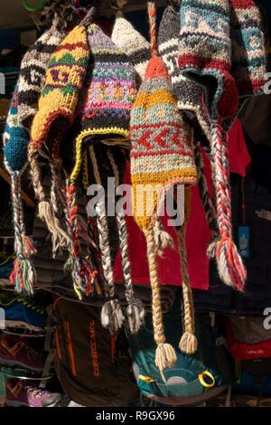 Nepal, Everest Base Camp Trek, Khumjung village, hand knitted warm woolen hats for sale on souvenir stall - Stock Image