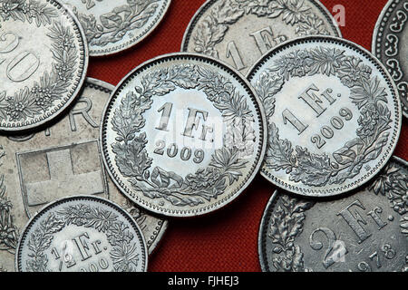 Coins of Switzerland. Swiss one franc coins. - Stock Image