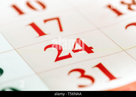 Calendar fragment perspective shot with partial blurred areas. Number 24 in focus - Stock Image