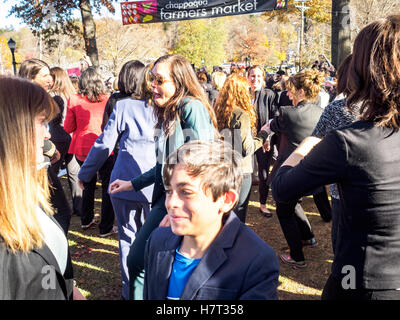 Chappaqua, NY, USA - 8 November 2016. Members of a Pantsuit Up flash mob dancing in presidential candidate Secretary - Stock Image