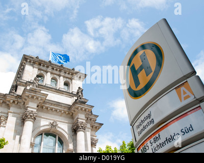 Public transport H bus stop sign outside the Reichstag in Berlin Germany - Stock Image