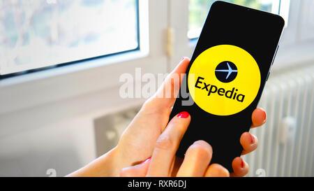 Expedia travel app hand icon smartphone - Stock Image
