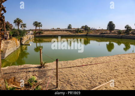 The Sacred lake at the Karnak Temple Complex, also known as The Temple of Karnak, in Thebes, Luxor, Egypt - Stock Image