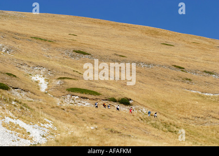 Hikers on Monte Sibilla in the Sibillini National Park,Le Marche,Italy - Stock Image