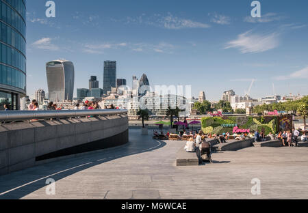 London Riviera pop up restaurant on the Southbank at More London Riverside, with modern city architecture skyline - Stock Image