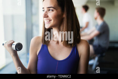 Close up image of attractive fit woman in gym - Stock Image