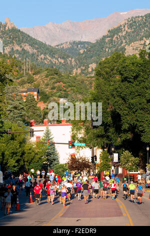 Runners start a rugged race up 14,115 foot Pikes Peak on the Barr Trail near Manitou Avenue in Manitou Springs Colorado - Stock Image