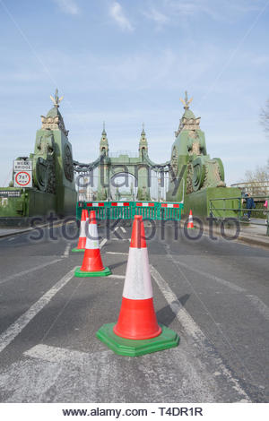 Traffic cones block Hammersmith Bridge which has now been closed indefinitely to cars and buses but still open for pedestrians and cyclists - Stock Image