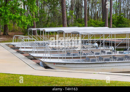 Okefenokee Swamp, Folkston, GA, USA-3/29/19: Tourist skiffs docked at the canal at eastern entrance to the swamp. - Stock Image