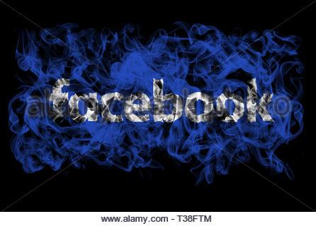 Smoking flag of Facebook - Stock Image