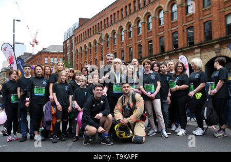 Mayor of Greater Manchester Andy Burnham poses for a photo prior to the Simply Health Manchester Run. - Stock Image