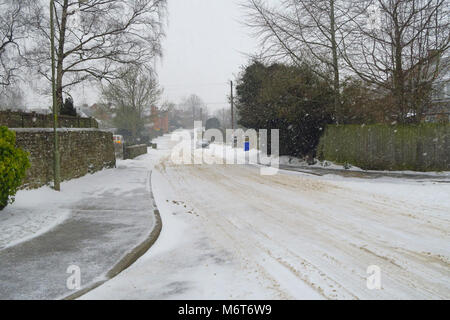 The Bourne after a March snowfall, Hook Norton, Oxfordshire - Stock Image