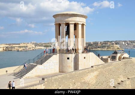 The Siege Bell Memorial on the southern tip of the Maltese capital Valletta. It commemorates the 7,000 who died in the Siege between 1940-43 - Stock Image