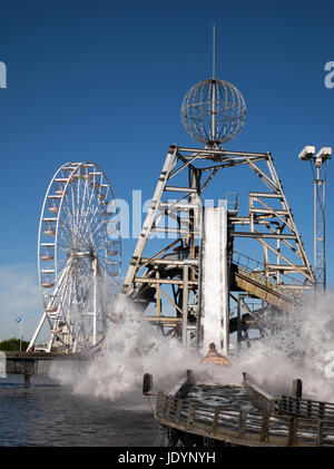 The Log Flume Ride hitting the water at The Pleasure Beach in Great Yarmouth with The Big Ferris Wheel beyond, Great - Stock Image
