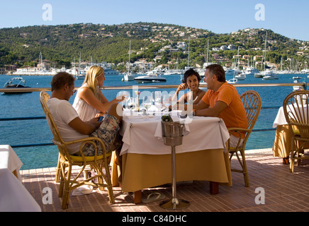 Puerto d'Andratx, couples enjoying the end of the day - Stock Image