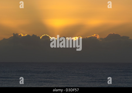 Sunrise over ocean - Stock Image