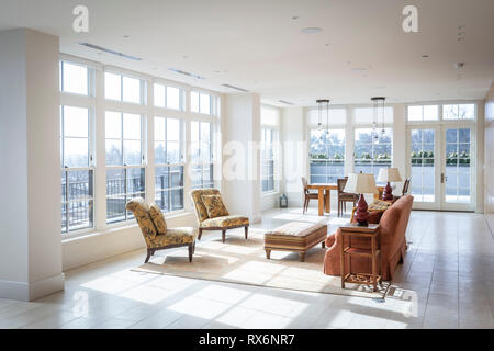 Residential Interior Large Living Room With Floor To Ceiling Windows - Stock Image