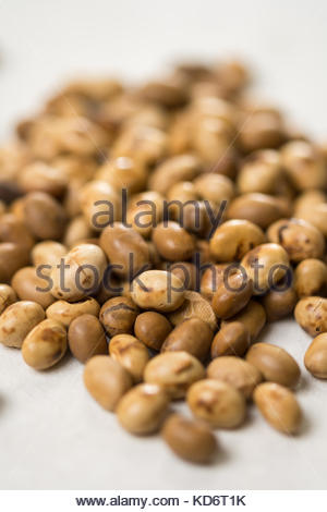 Selective focus on soya beans on the white marble background table. - Stock Image