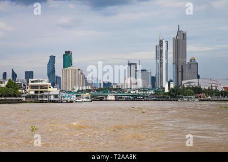 Bangkok, Thailand - August 29, 2018: Modern skyscrapers seen from the Chao Phraya river, Bangkok, Thailand. - Stock Image