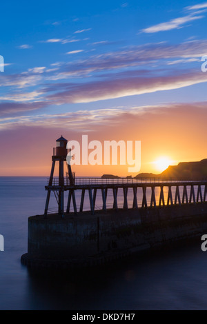 The East Pier at Whitby at sunrise. - Stock Image