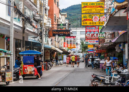Patong Beach, Thailand - 6th January 2017: Shops and restaurants off the main beach road. Phuket is a renowned holiday destination. - Stock Image