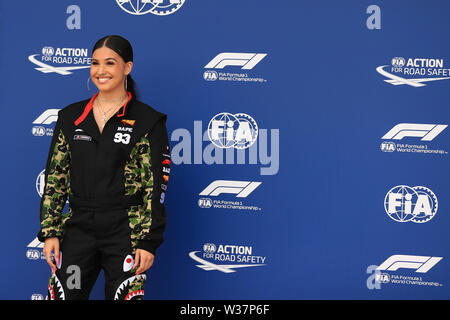 Silverstone Circuit. Northampton, UK. 13th July, 2019. FIA Formula 1 Grand Prix of Britain, Qualification Day; Pirelli Representative, pop star Mabel McVey Credit: Action Plus Sports/Alamy Live News - Stock Image