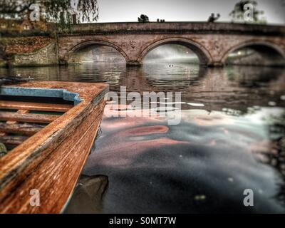 Punting on the river Cam at dusk in Cambridge, UK - Stock Image