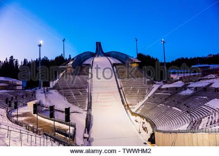The world famous Holmenkollen  ski jump, Oslo, Norway (aka Holmenkollbakken.) It has been a site for ski jumping since 1892. The stadium has a capacit - Stock Image