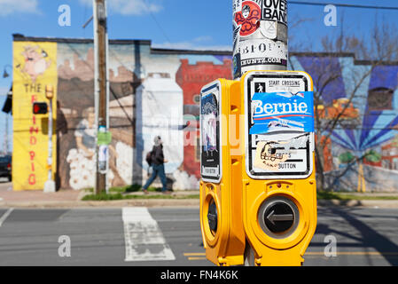 Bernie sticker above Street Crossing button, in the artsy neighborhood NoDa (North Davidson), Charlotte, North Carolina. - Stock Image
