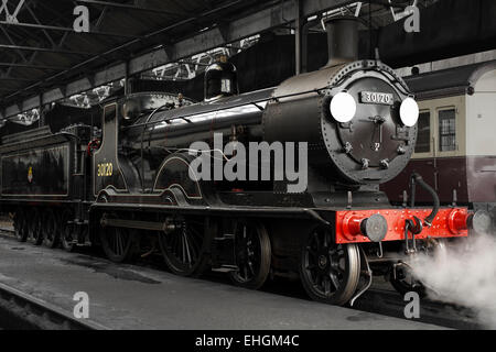 Preserved T9 class (greyhound) steam locomotive at Didcot Railway Centre, inside the engine shed. - Stock Image