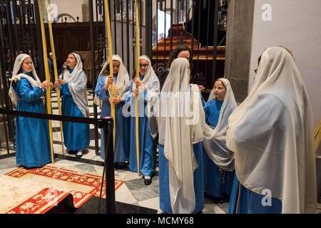 Tenerife, Canary Islands, girls preparing to lead the Palm Sunday Holy Week procession in the Cathedral of San Cristobal de La Laguna. - Stock Image