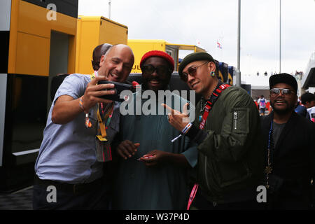 Silverstone Circuit. Northampton, UK. 13th July, 2019. FIA Formula 1 Grand Prix of Britain, Qualification Day; Will i am shares a joke in the paddock Credit: Action Plus Sports/Alamy Live News - Stock Image
