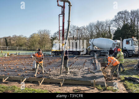 Presteigne, Powys, Wales, UK. Pumping ready mix concrete to form the floor of a new building - Stock Image