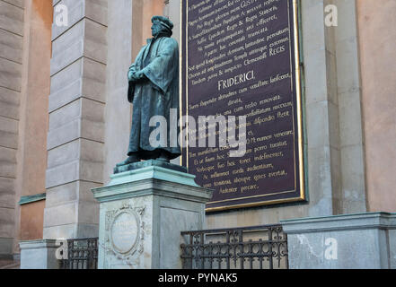 Statue of Olavus Petri, a principal leader of the Lutheran movement  outside Storkyrkan (The Great Church), Gamla Stan, Stockholm, Sweden - Stock Image