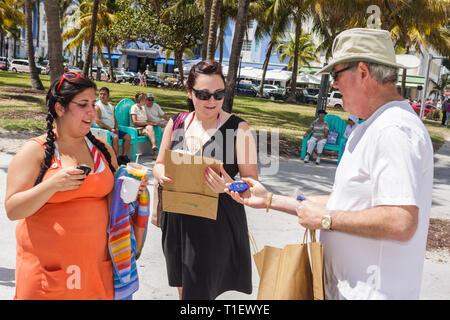 Miami Beach Florida Lummus Park No Litter No Butts biodegradable trash bag portable ash tray Litter No Butts pollution environme - Stock Image