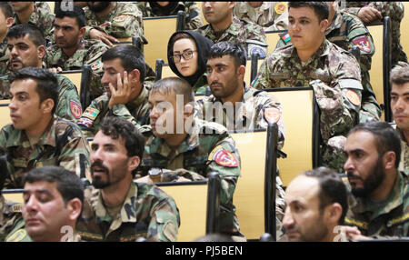KABUL, Afghanistan (August 29, 2018) -- Afghan soldiers listen to remarks given during the Afghan National Army Sergeant Major Academy graduation ceremony at Camp Qurgha, Afghanistan, August 29, 2018. The class of 80 included four females.  (U.S. Army photo by Staff Sgt. Shaiyla Hakeem) - Stock Image