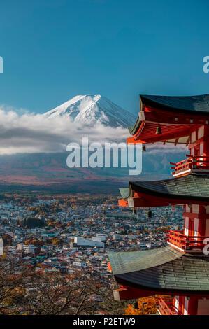 Close-up of Chureito Pagoda with Mt. Fuji and city in background, Fujiyoshida, Yamanashi Prefecture, Japan - Stock Image