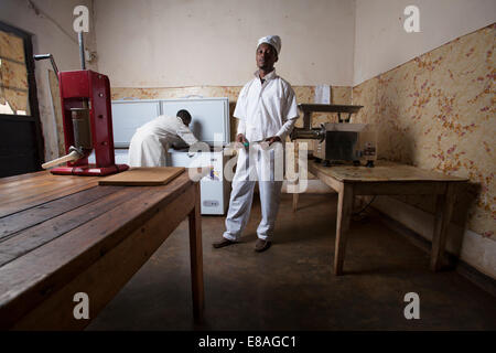 African butcher poses in his meat processing room, Kigali, Rwanda - Stock Image