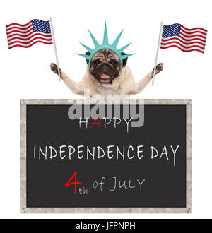 pug puppy dog with American flag and statue of liberty crown, behind blackboard with text happy 4th of July and - Stock Image