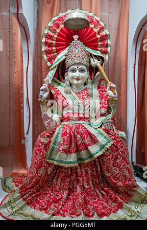 A statue of Santoshi Mata, A Hindu goddess. At the Satya Narayan Mandir Hindu temple in Elmhurst, Queens, New York City - Stock Image